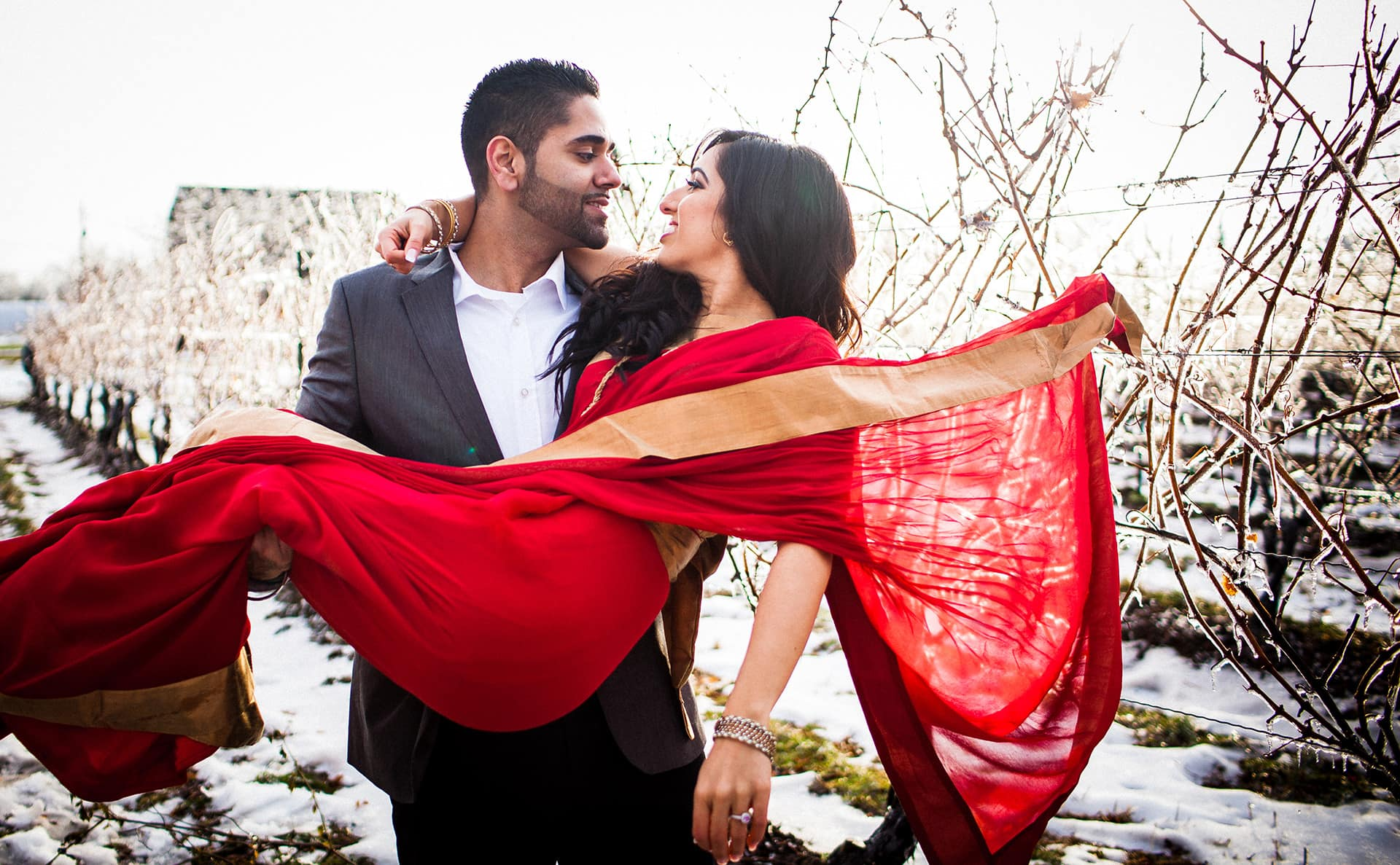 The bride-to-be gets her red sari caught on a branch.