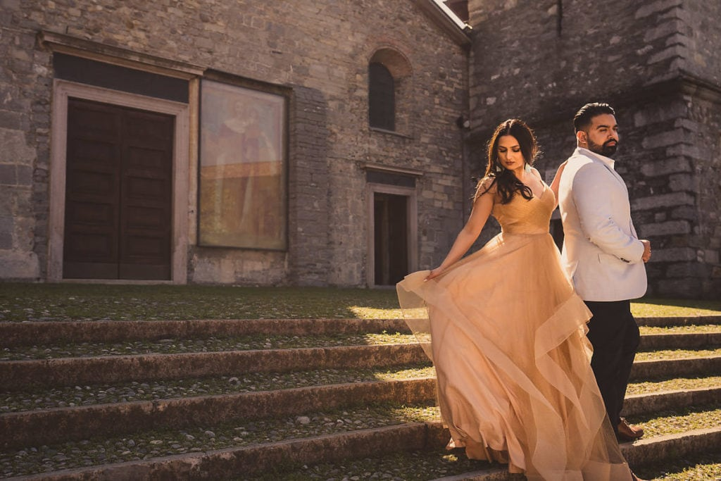 Engagement photo session in Varenna, Lake Como. Bride in princess like  golden dress.