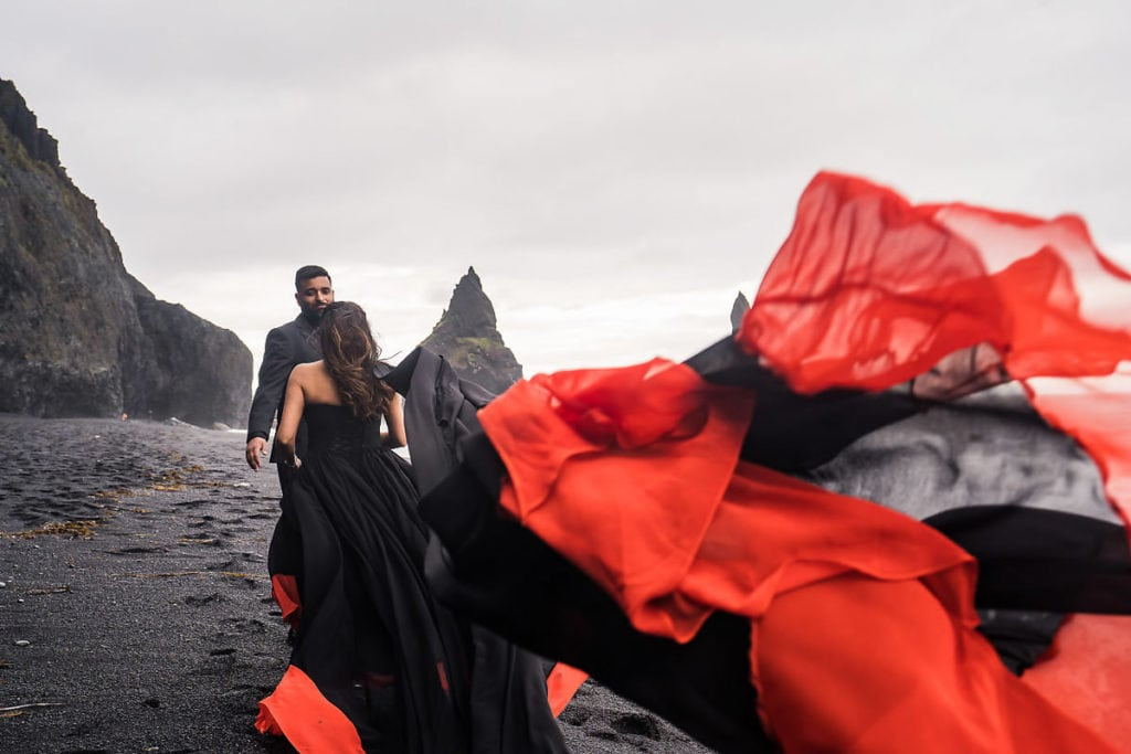 Couple photoshoot at Black beach in Iceland