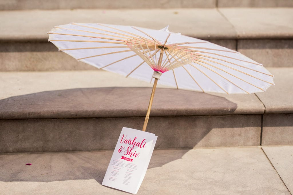 Paper umbrella serves two purposes at this outdoor Indian wedding - decor and shade