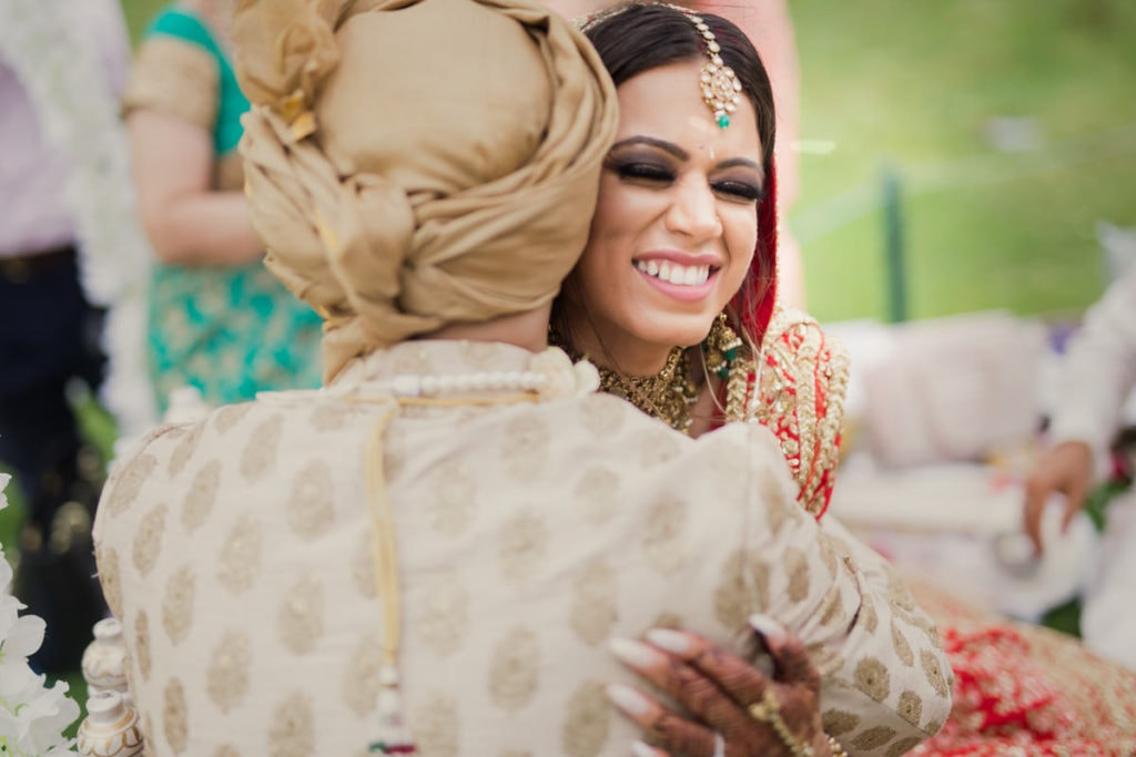 Indian Bride and Groom share intimate laughter throughout the ceremony