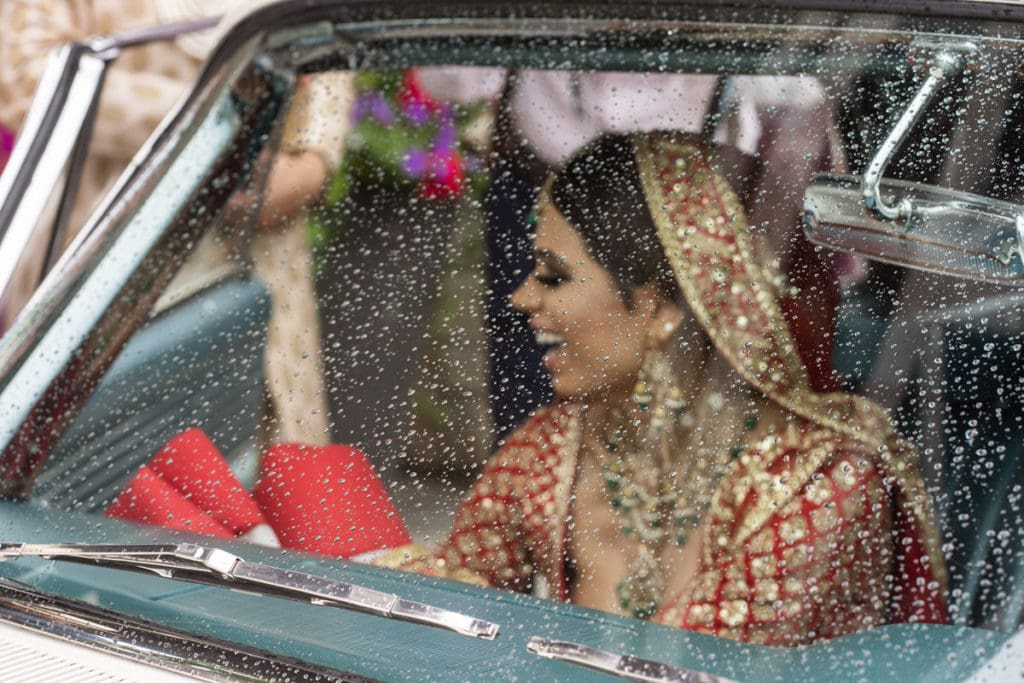 Bride smiles at her doli