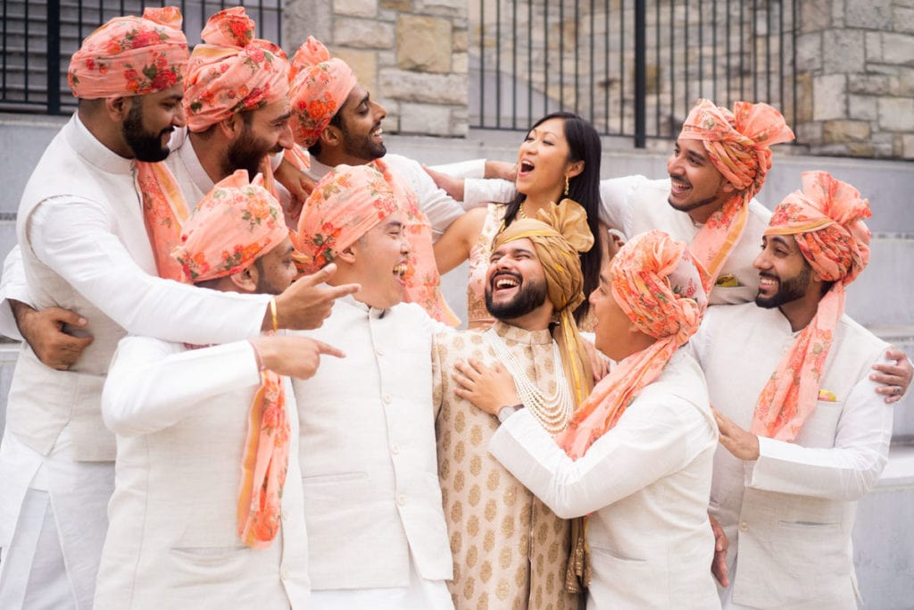 Groom shares laughter with his groomsmen and best friend