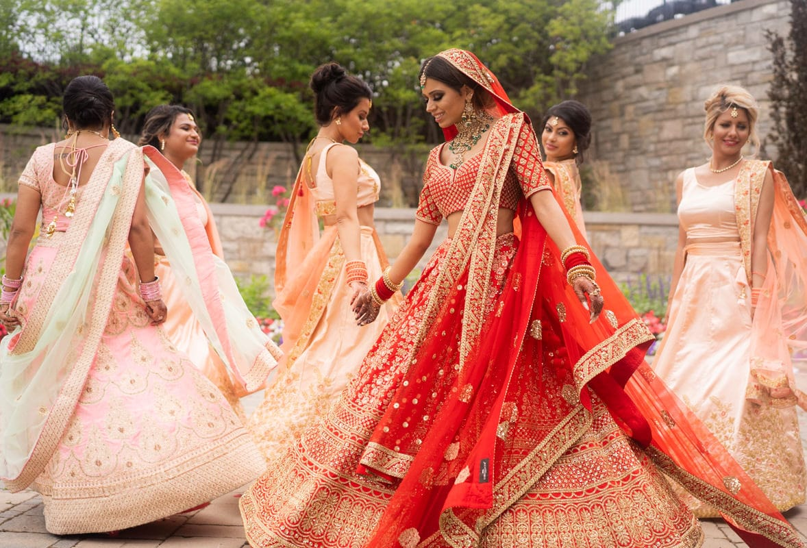 Indian Bride and bridesmaids twirling