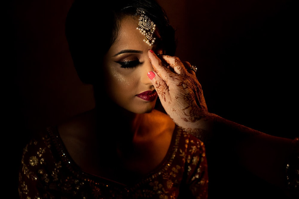Indian Sikh Bride in red and gold outfit getting ready before her Indian Sikh Wedding at Scarborough Gurdwara