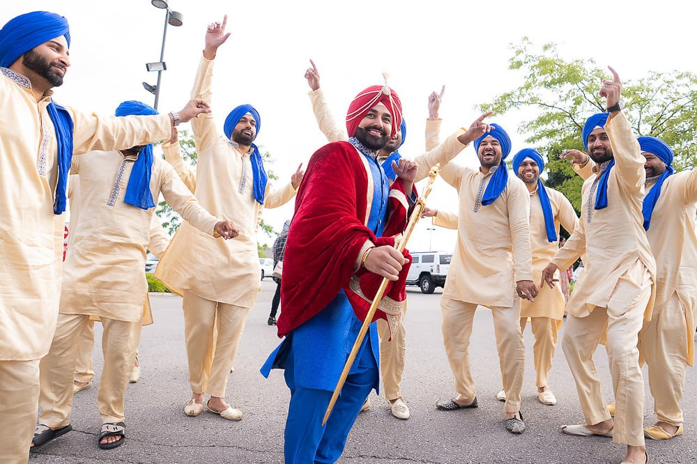 Indian Sikh groom in blue and red outfit at Scarborough Gurdwara