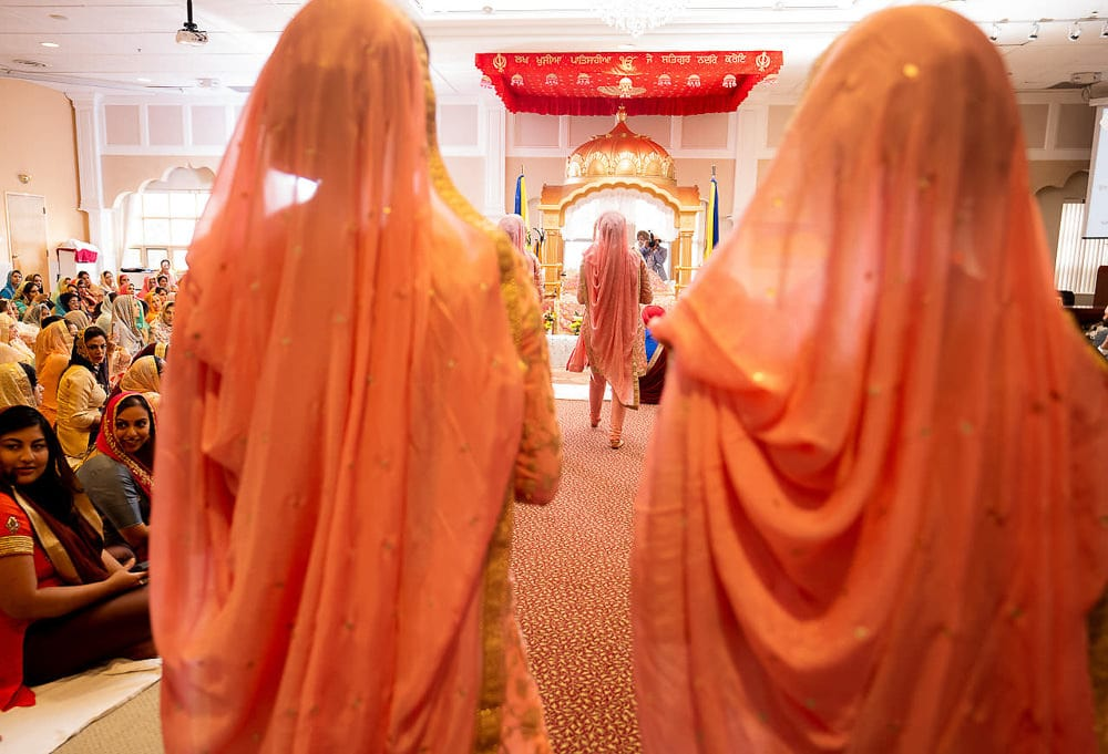 Indian bridesmaids entering Scarborough Sikh Gurdwara Toronto
