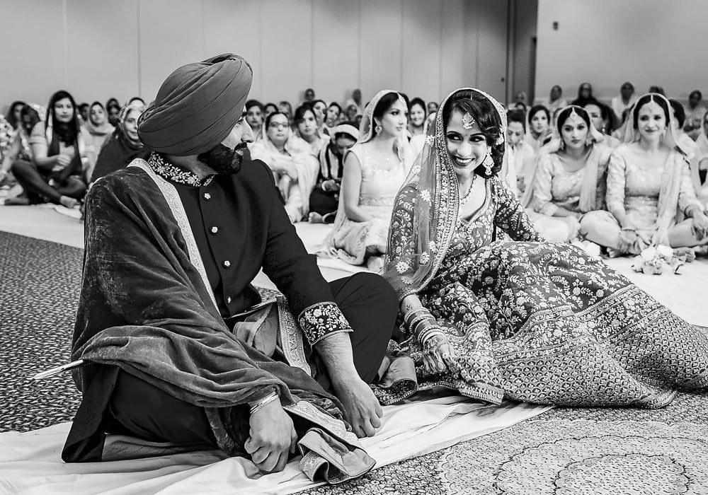 Traditional First Look during wedding ceremony. Indian Sikh Wedding.