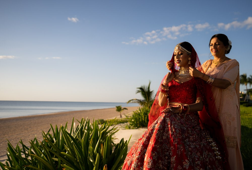 Moon Palace Sikh Hindu Indian Wedding in Cancun Mexico. Indian Bride in Red with Mother.