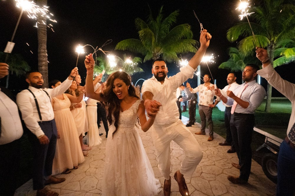 Moon Palace Sikh Hindu Indian Wedding in Cancun Mexico Sparkler Exit by Couple