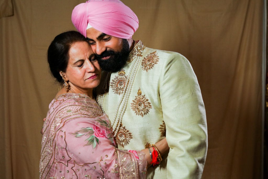 Ottawa Indian Sikh groom on the morning of his wedding ceremony with his mother