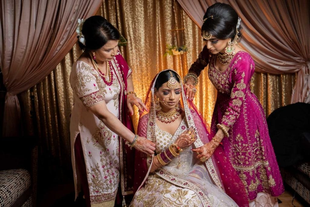 Ottawa Sikh bride with mother and sister on morning of her wedding ceremony