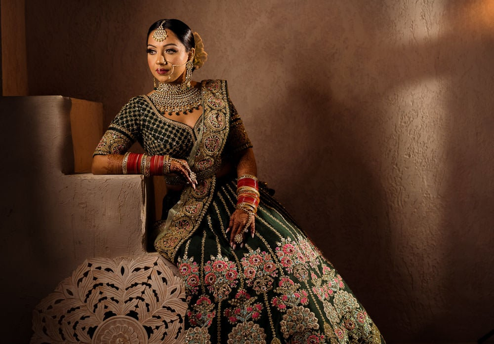 Indian bride in green Sabyasachi Lehenga at Moroccan-inspired photoshoot.