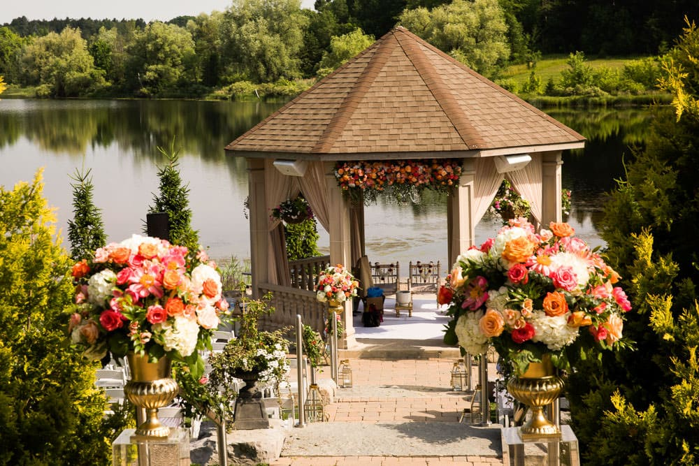 Lavish floral Indian Wedding in Toronto at the Royal Ambassador's gazebo with Innis Lake in the backdrop