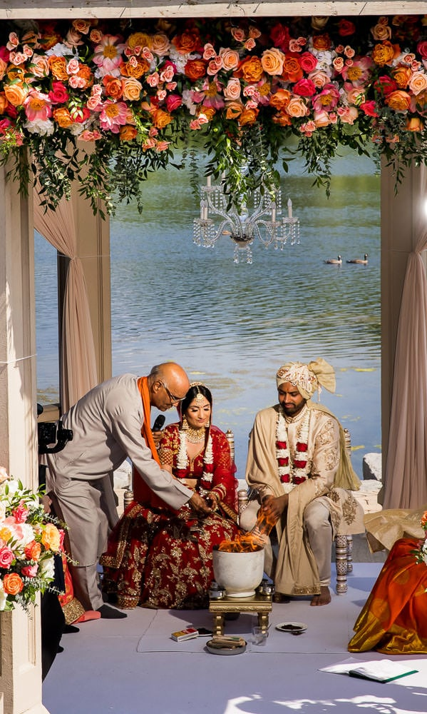 Pandit Ji blesses couple at their outdoor Hindu wedding ceremony at the Royal Ambassador.