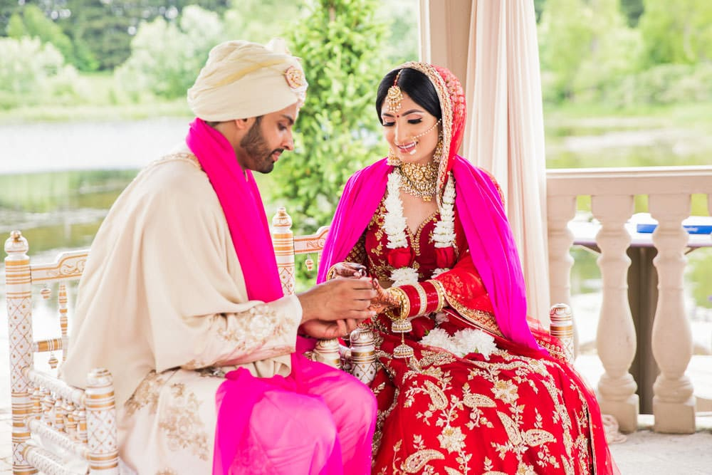 Indian Bride and Groom share a moment at their outdoor Indian wedding at the Royal Ambassador, Toronto.