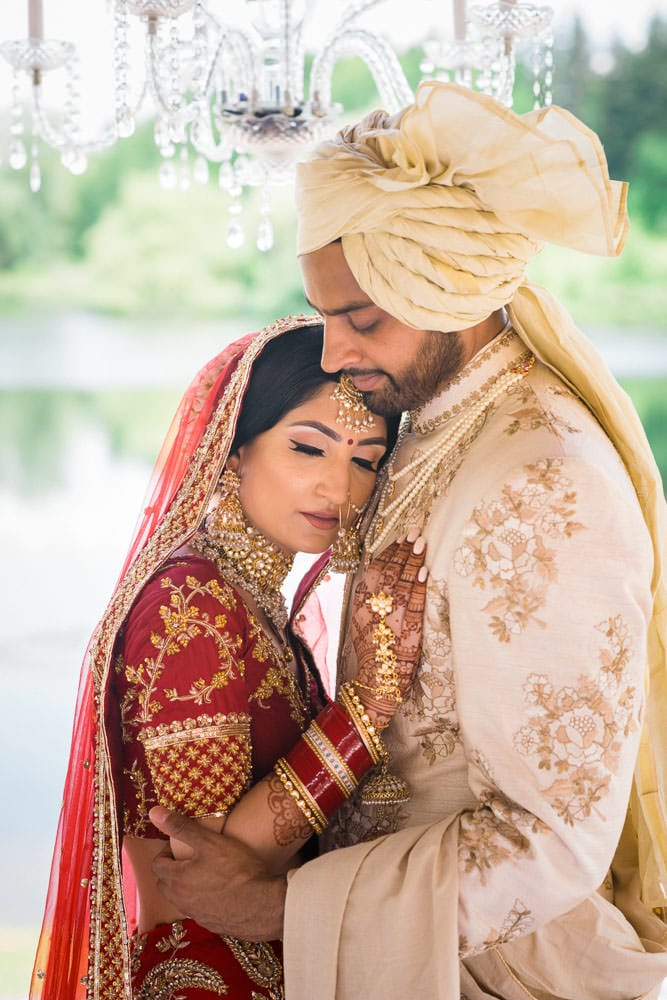 Indian Bride and Groom at the Royal Ambassador gazebo for their floral Indian wedding.
