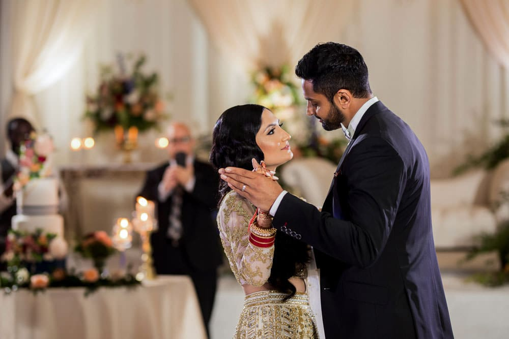 First dance as Mr and Mrs at this Floral Indian wedding at The Ritz-Carlton, Toronto.