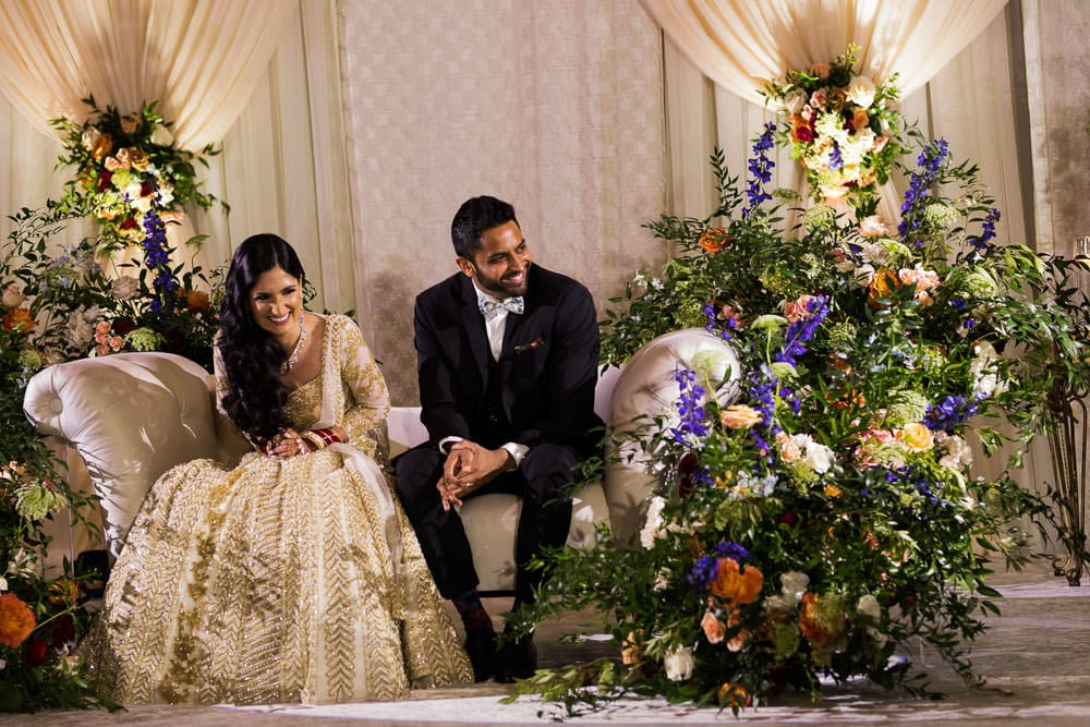 Indian couple shares a laughplays at their Floral Indian wedding at The Ritz-Carlton, Toronto.