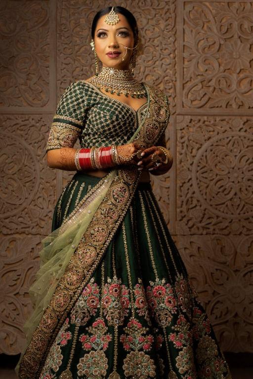 Indian bride in green Sabyasachi Lehenga at Moroccan-inspired photoshoot.