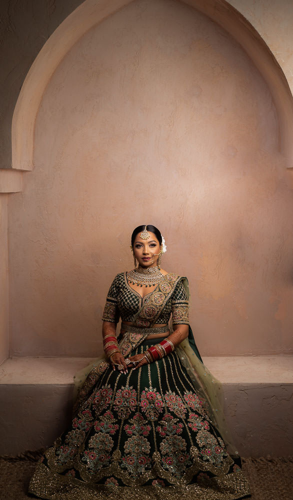 Posing as an Indian Bride. Indian bride in green Sabyasachi Lehenga at Moroccan-inspired photoshoot.