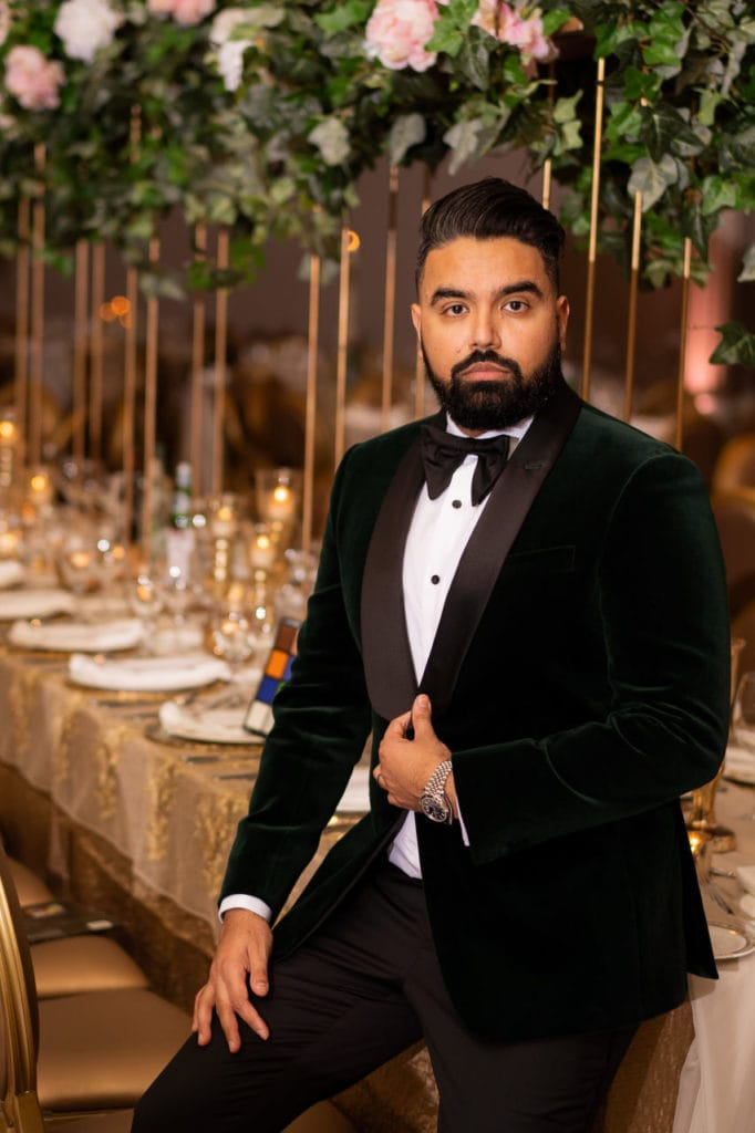 Dapper Indian groom in velvet tuxedo at the Bellvue manor.