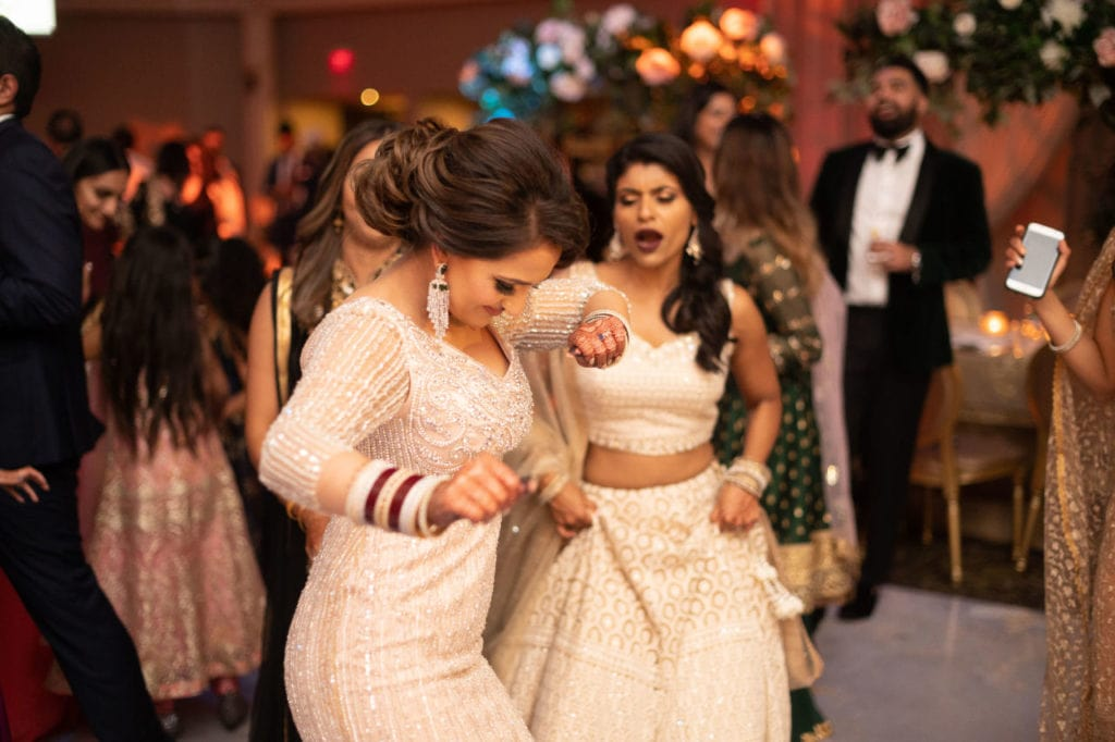 Modern Indian couple at their glamorous reception at the Bellvue Manor, Toronto. Bride dancing the night away.