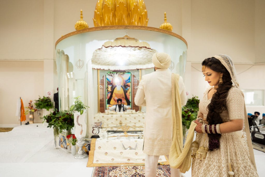 Sikh wedding ceremony the Anand Karaj at Nanaksar Gurdwara in Brampton, Toronto.