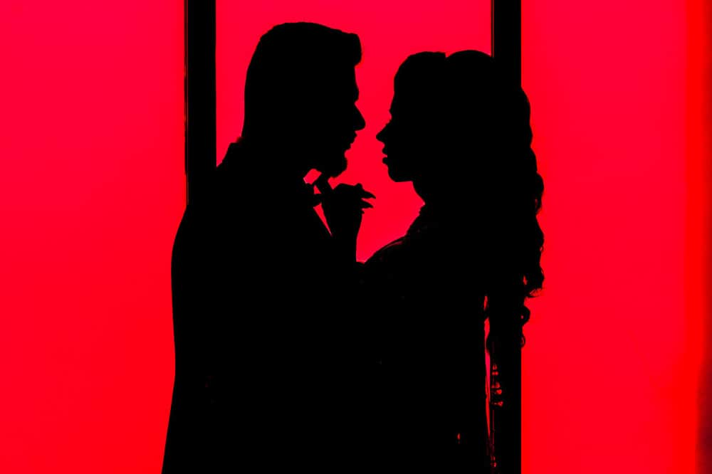 Silhouette of Modern Indian couple photoshoot at her  at Embassy Grand Indian Reception