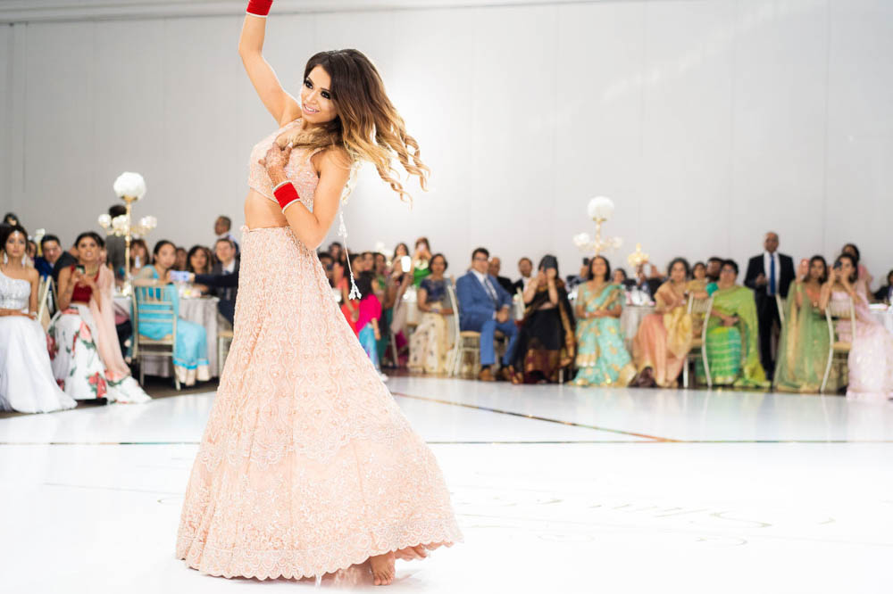 Modern Indian bride does a surprise Bollywood dance performance their Embassy Grand Indian Reception