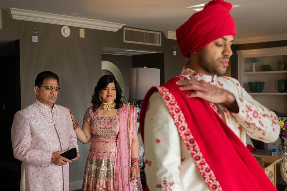 Indian groom with parents at beach wedding at Westin Hilton Head