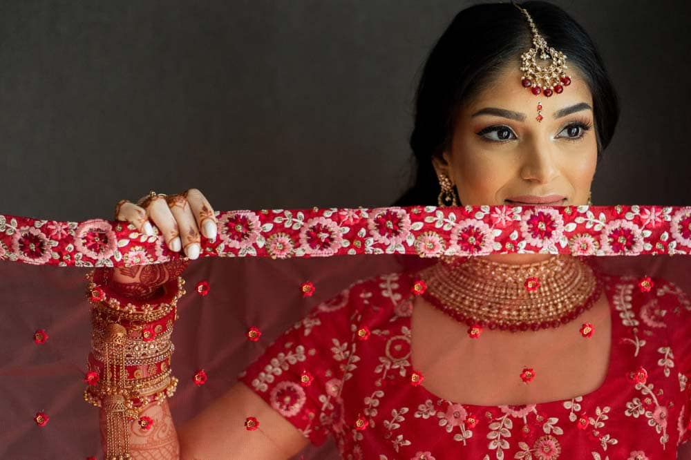 Bride in red lehenga at Hilton Head Indian Wedding