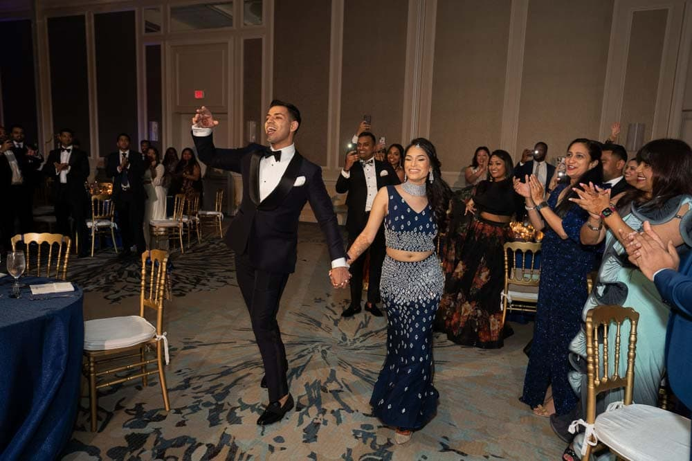 Modern Indian couple makes their grand entrance at Hilton Head Indian Wedding Reception