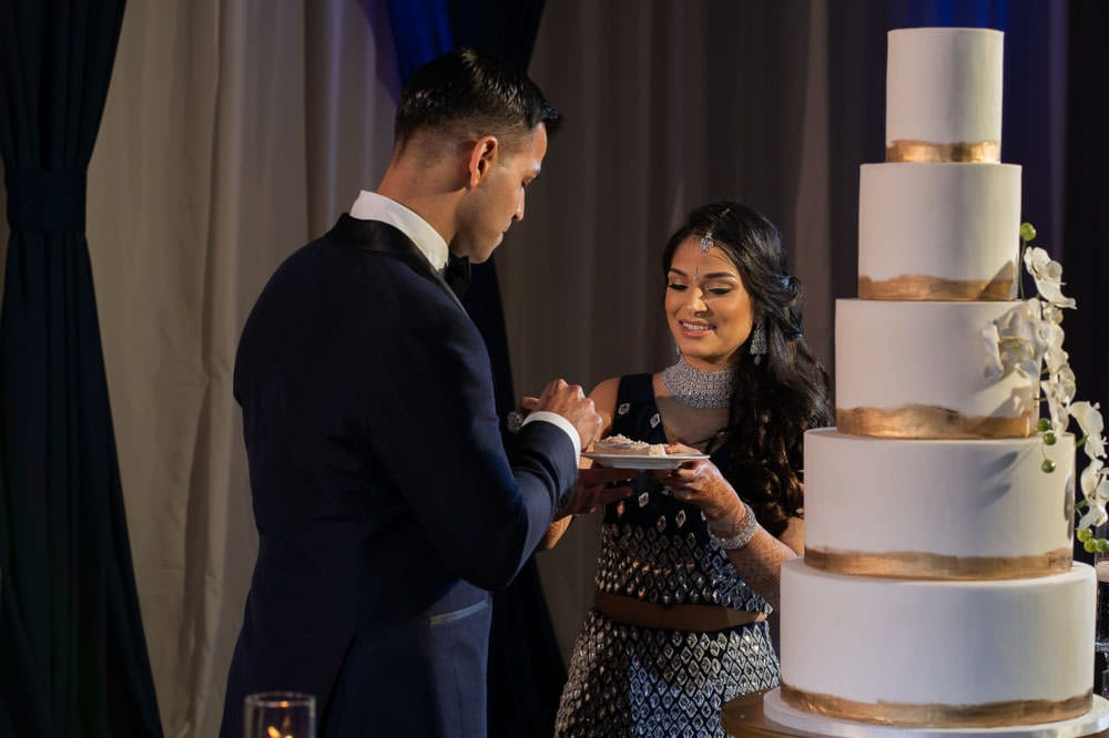 Indian couple cake cutting ceremony at Hilton Head Indian Wedding Reception